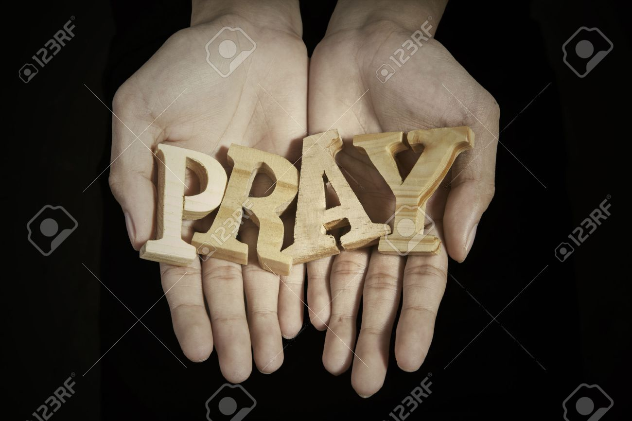 Close up of prayer hands showing a word of pray in dark background Banque d'images - 54428235