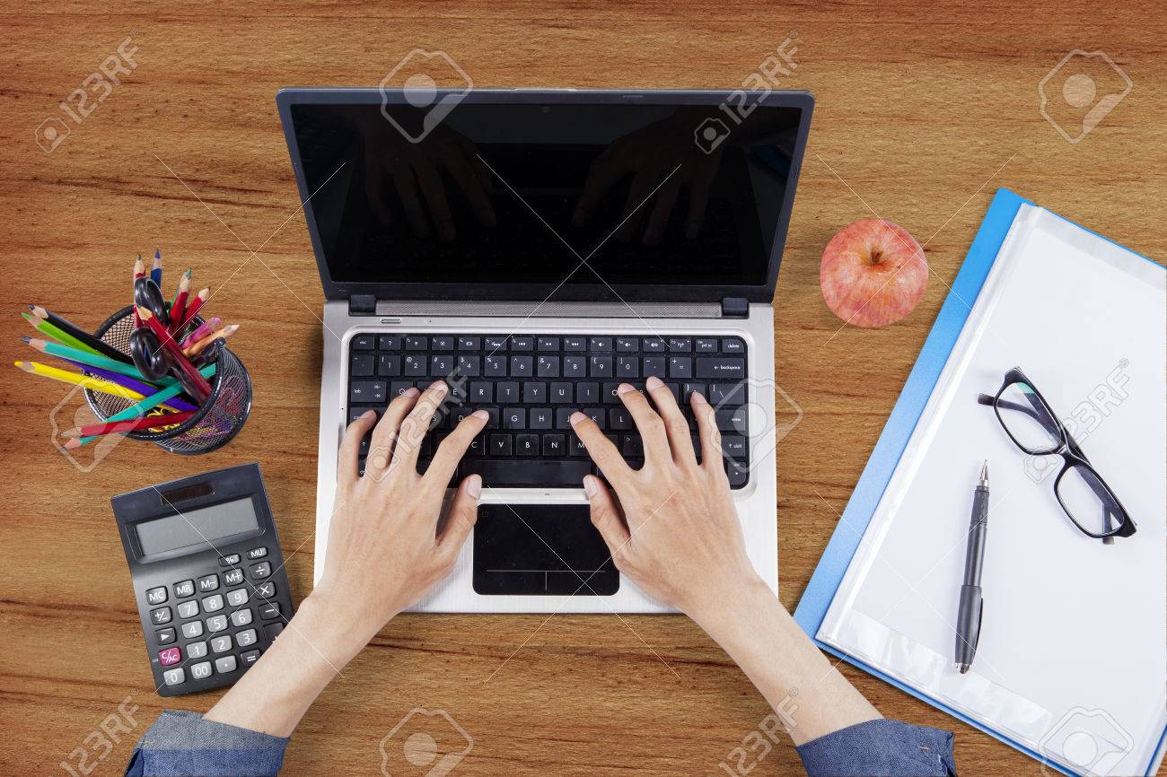 https://previews.123rf.com/images/ximagination/ximagination1604/ximagination160400582/55759359-top-view-of-male-hands-student-typing-on-the-laptop-computer-with-paperwork-and-stationery-at-the-wo.jpg