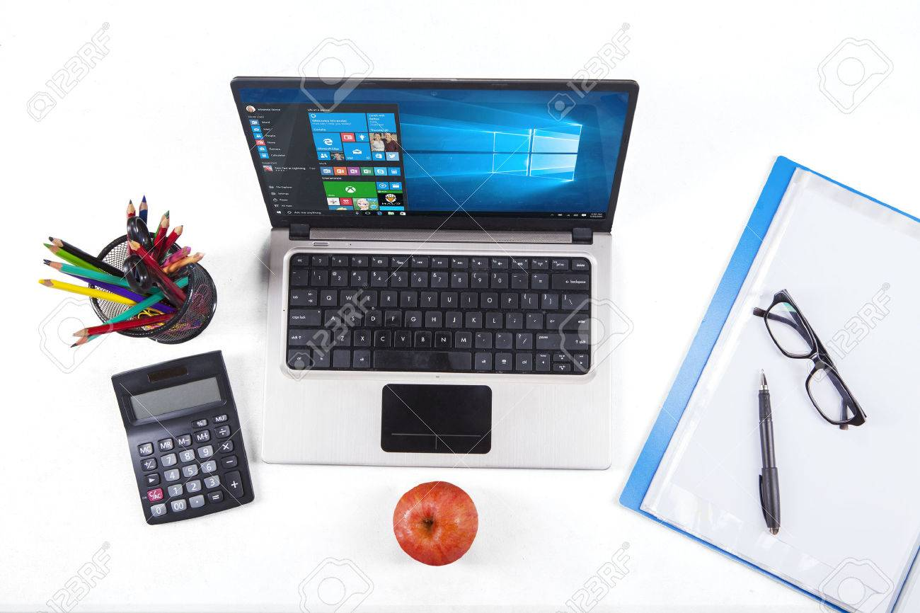 JAKARTA, SEPTEMBER 02, 2015: Closup of stationery and laptop computer using the new software of windows 10 Stock Photo - 57130409