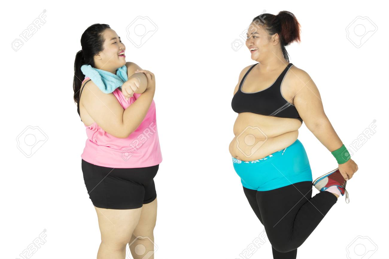 two fat women doing stretching and smiling together, isolated