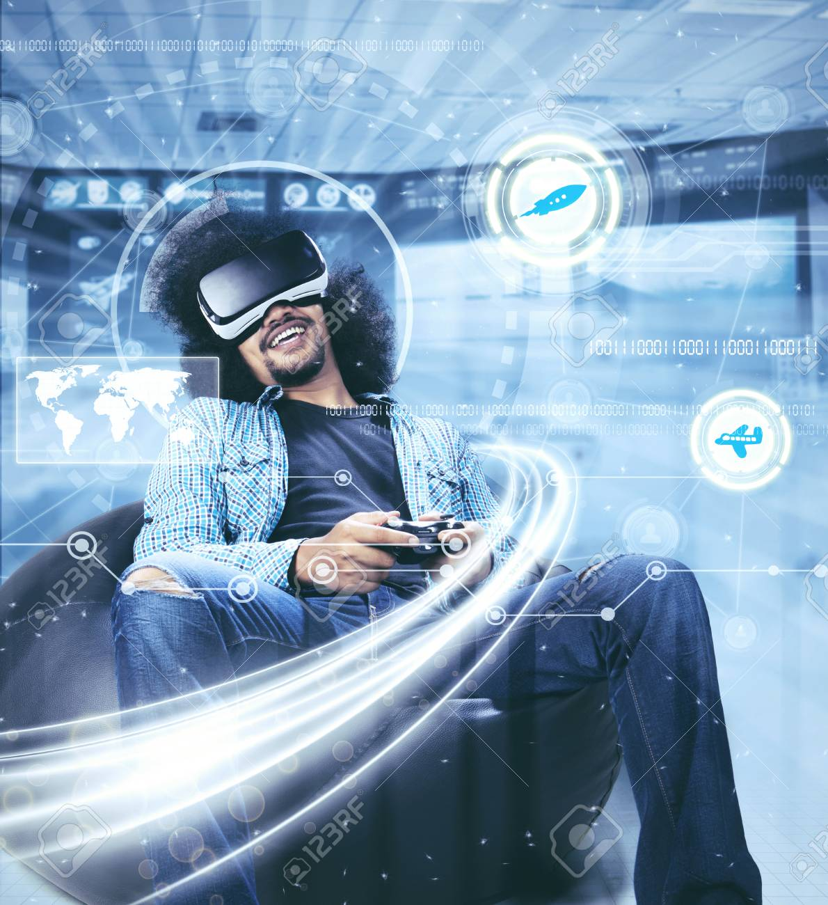 3646570a4351 Stock Photo - Young man is playing a video game with virtual reality  glasses and a joystick. Shot with futuristic screen