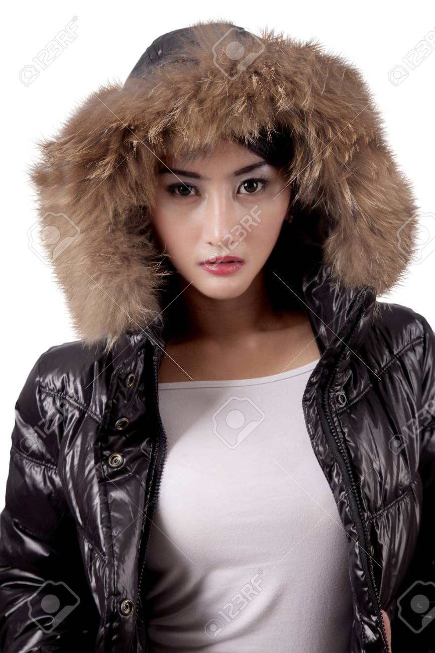 8863e1040817d Portrait of a beautiful young woman wearing a warm winter jacket with fur  hood Stock Photo
