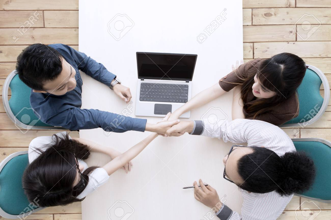 High Angle Photo Of Business People Comes To An Agreement In Stock