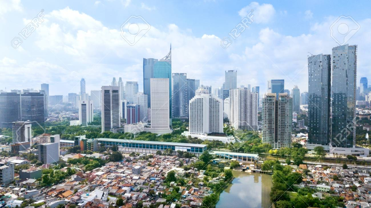 JAKARTA - Indonesia. March 12, 2018: Panoramic view of Jakarta cityscape with residential houses, modern office and apartment buildings at sunny day - 97779458