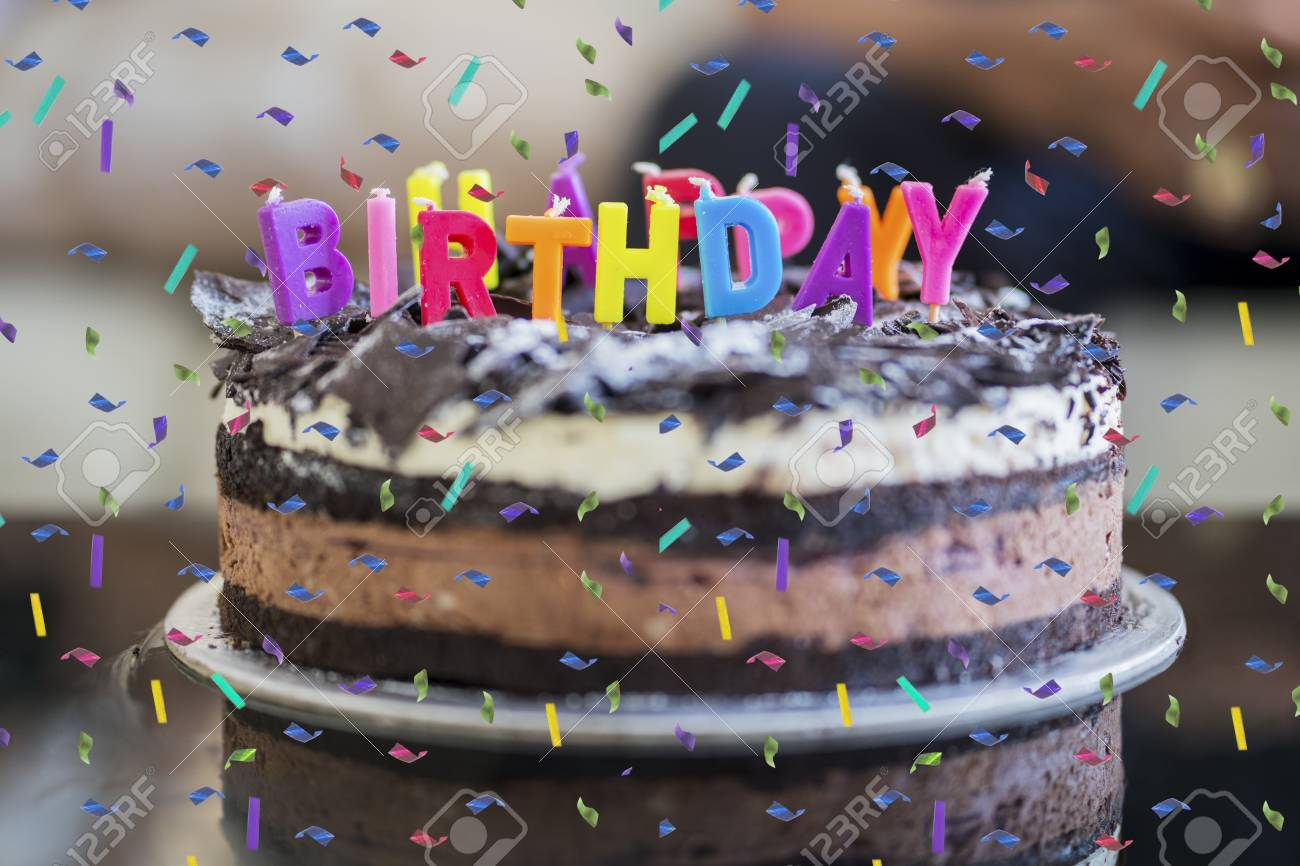 Chocolate birthday cake with confetti sprinkles and colorful
