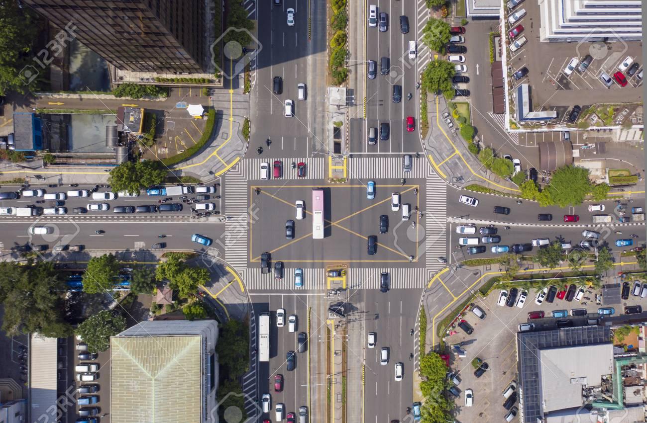 JAKARTA - Indonesia. Top view of vehicle on crossroads with crosswalk in Jakarta city - 116351655