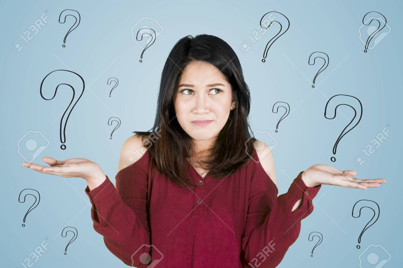 Picture of young Asian woman looks confused while standing with question marks - 126899865