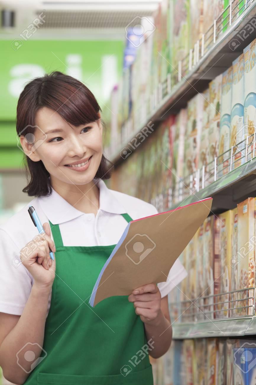 s clerk checking groceries in supermarket stock photo picture s clerk checking groceries in supermarket stock photo 35992312
