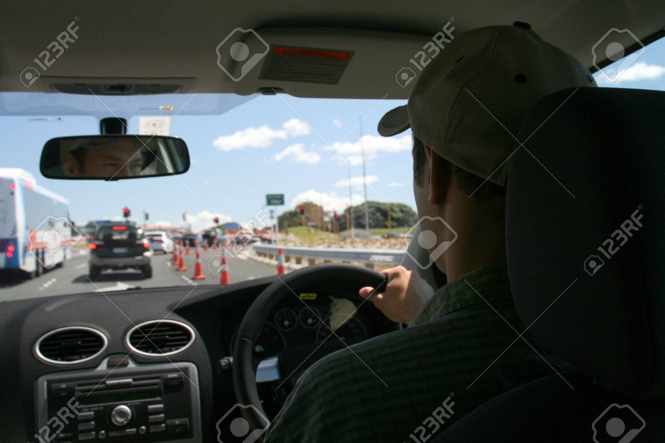 man driving on the left side Stock Photo - 648221