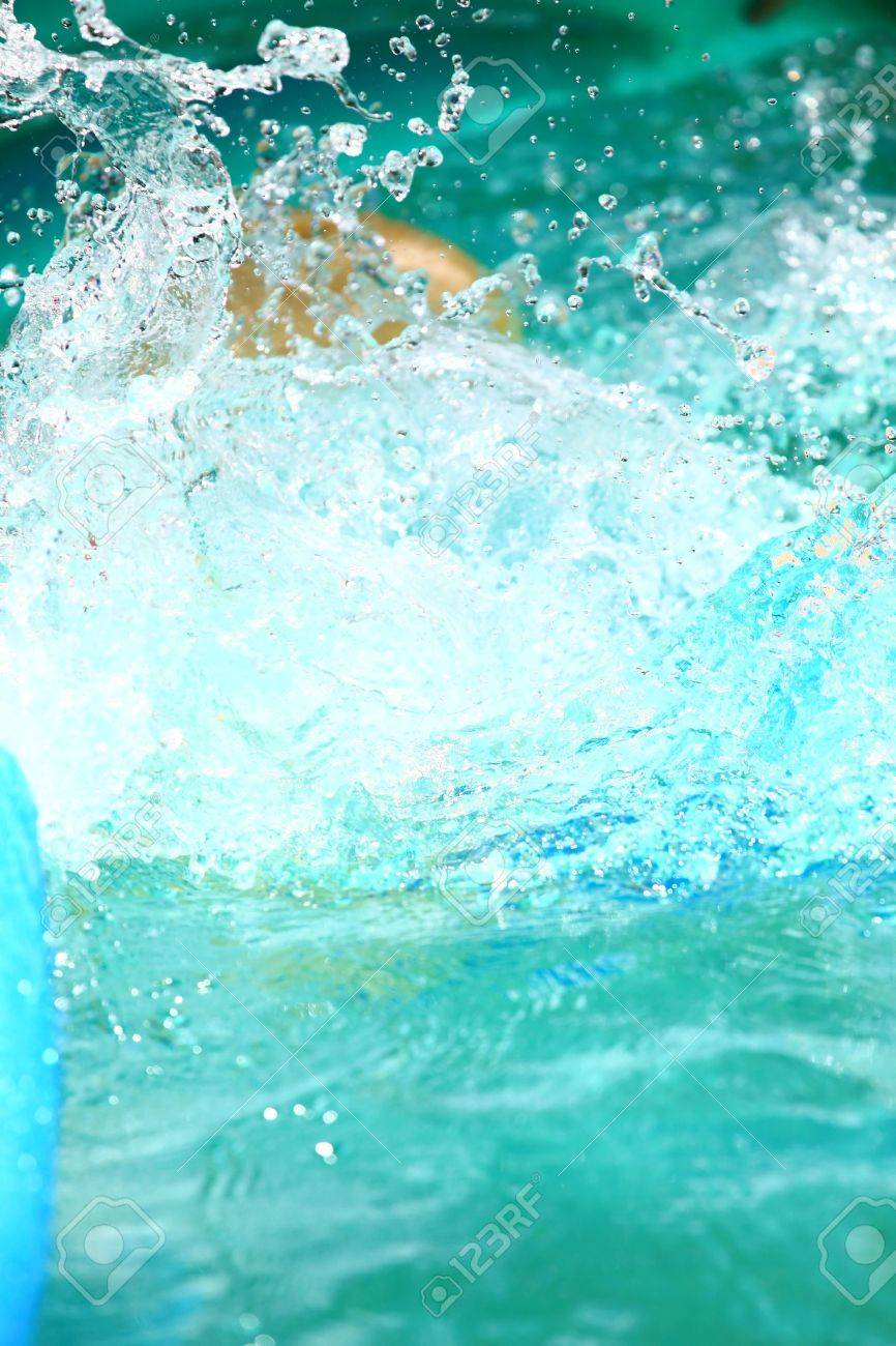 Pool Water Splash water splash in a blue pool stock photo, picture and royalty free