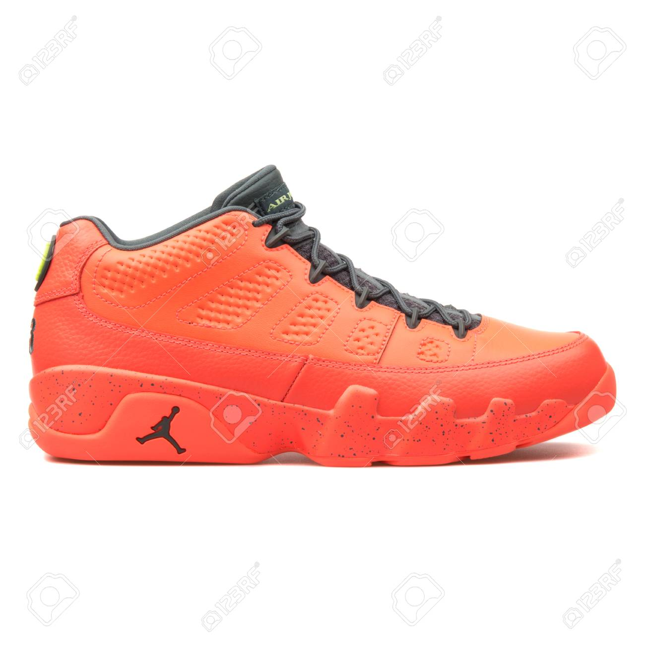 reputable site 6322c dccb5 Stock Photo - VIENNA, AUSTRIA - JUNE 14, 2017  Nike Air Jordan 9 Retro Low  bright mango sneaker isolated on grey background