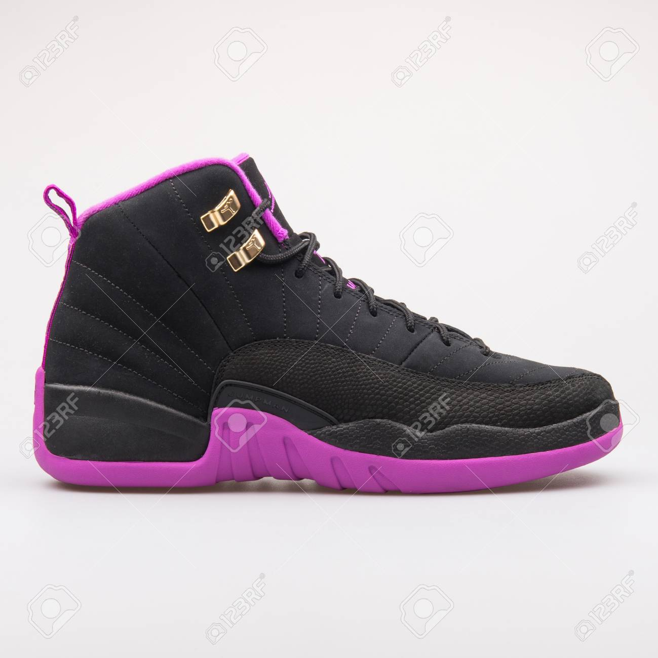 huge discount a5127 722f0 Stock Photo - VIENNA, AUSTRIA - JUNE 14, 2017  Nike Air Jordan 12 Retro OG  black and violet sneaker isolated on grey background