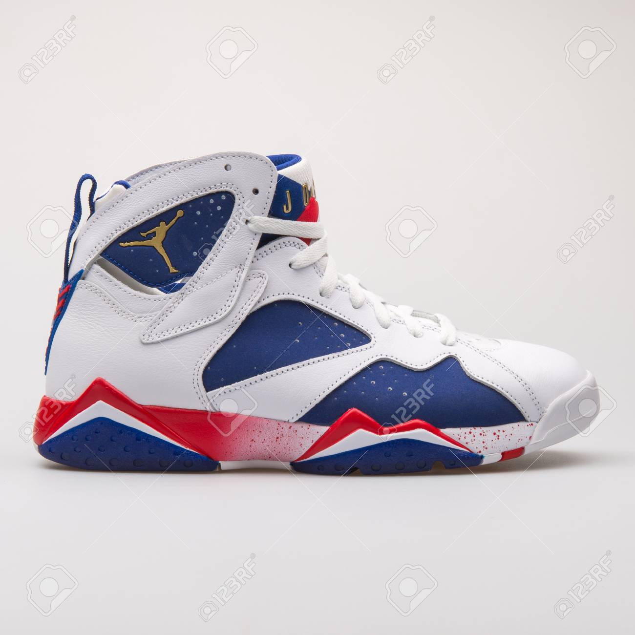 buy popular 602f5 1b861 Stock Photo - VIENNA, AUSTRIA - JUNE 14, 2017  Nike Air Jordan 7 Retro  white, blue and red sneaker isolated on grey background