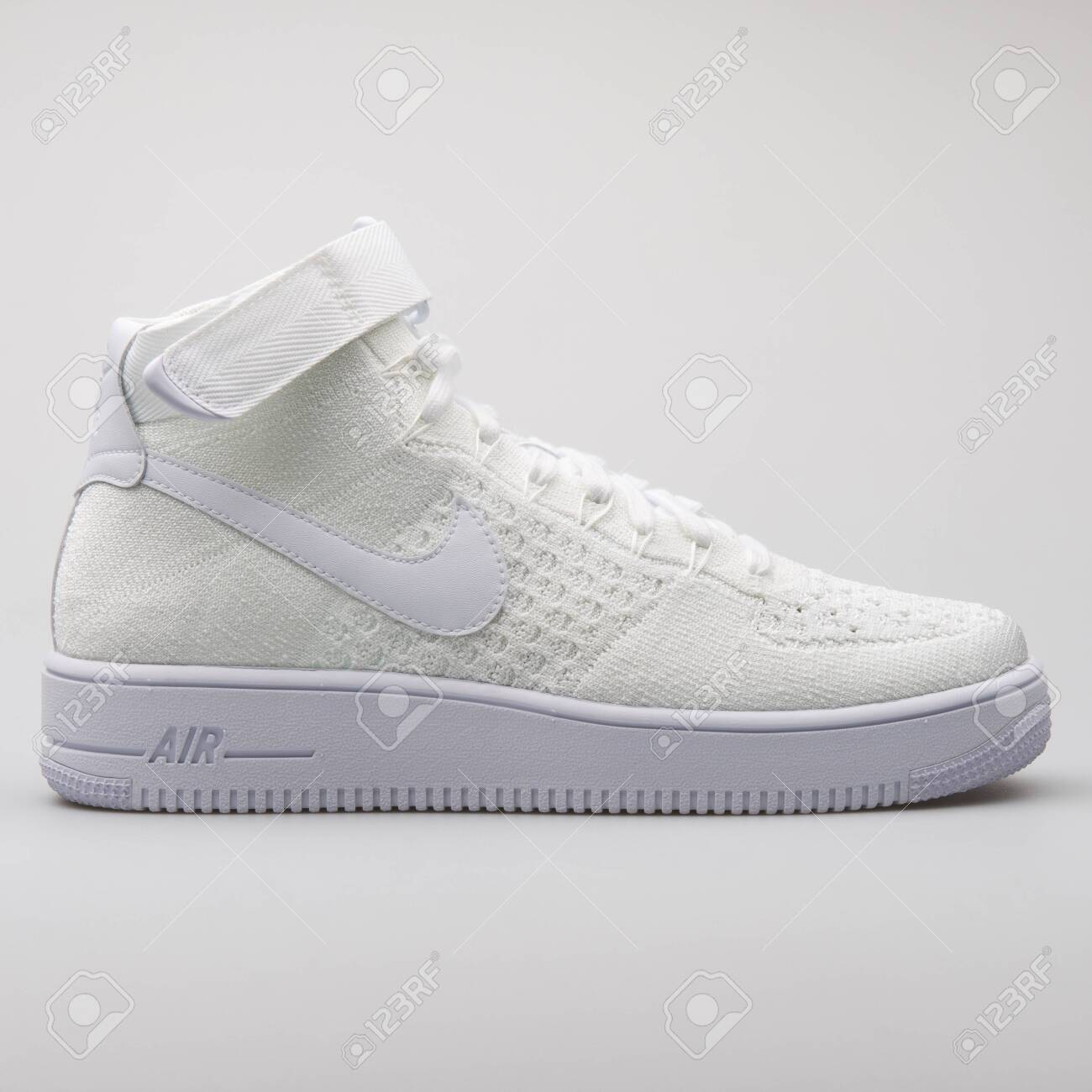 b6d37f29 Stock Photo - VIENNA, AUSTRIA - AUGUST 7, 2017: Nike Air Force 1 Ultra  Flyknit Mid white sneaker on white background.