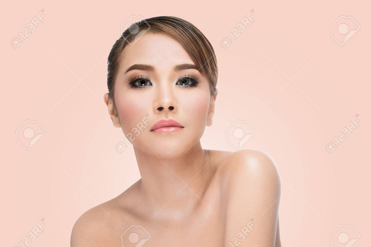 An Asian Beauty Looking At Smartphone In Coffee Shop Stock Photo ...