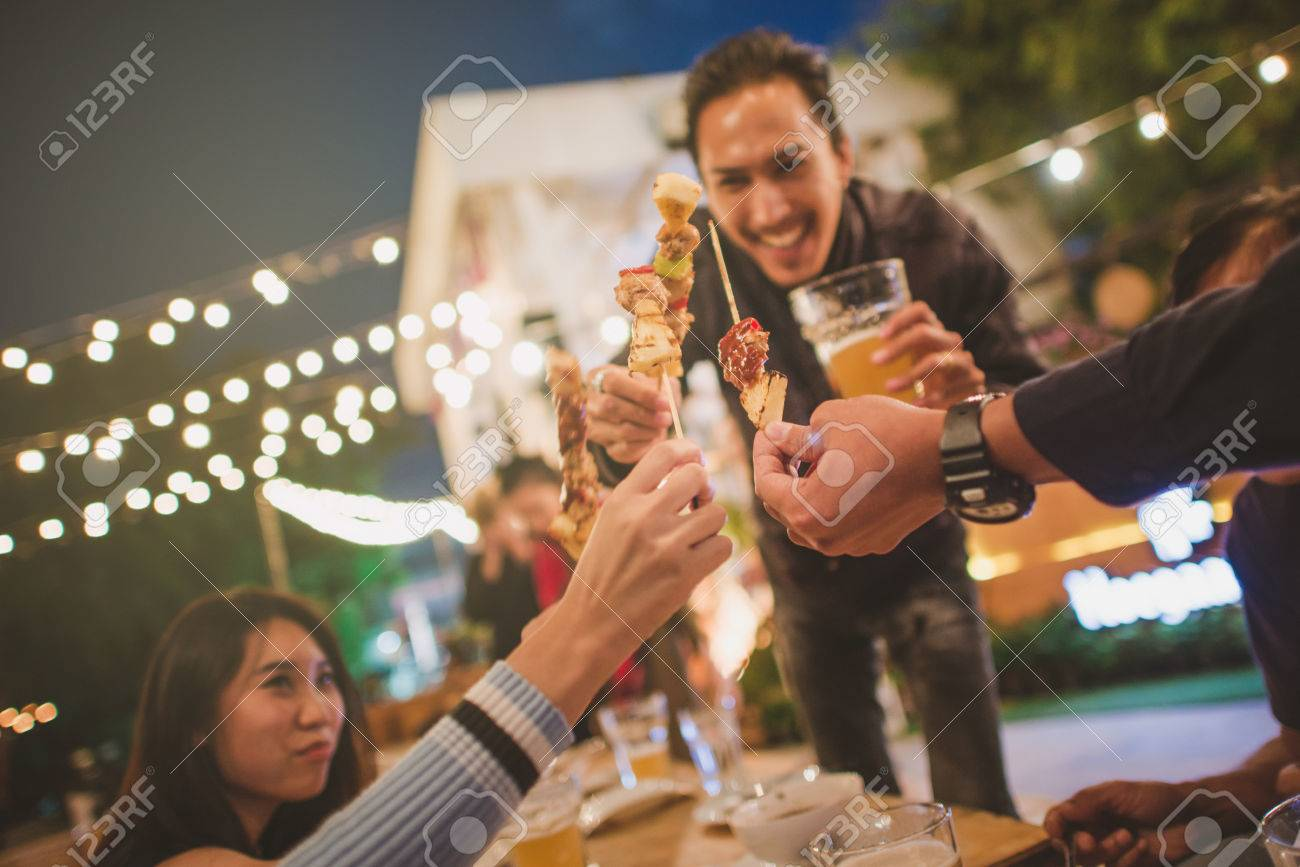 Happy Group of friends toasting and drinking beer at bbq party,vintage style. - 80248866