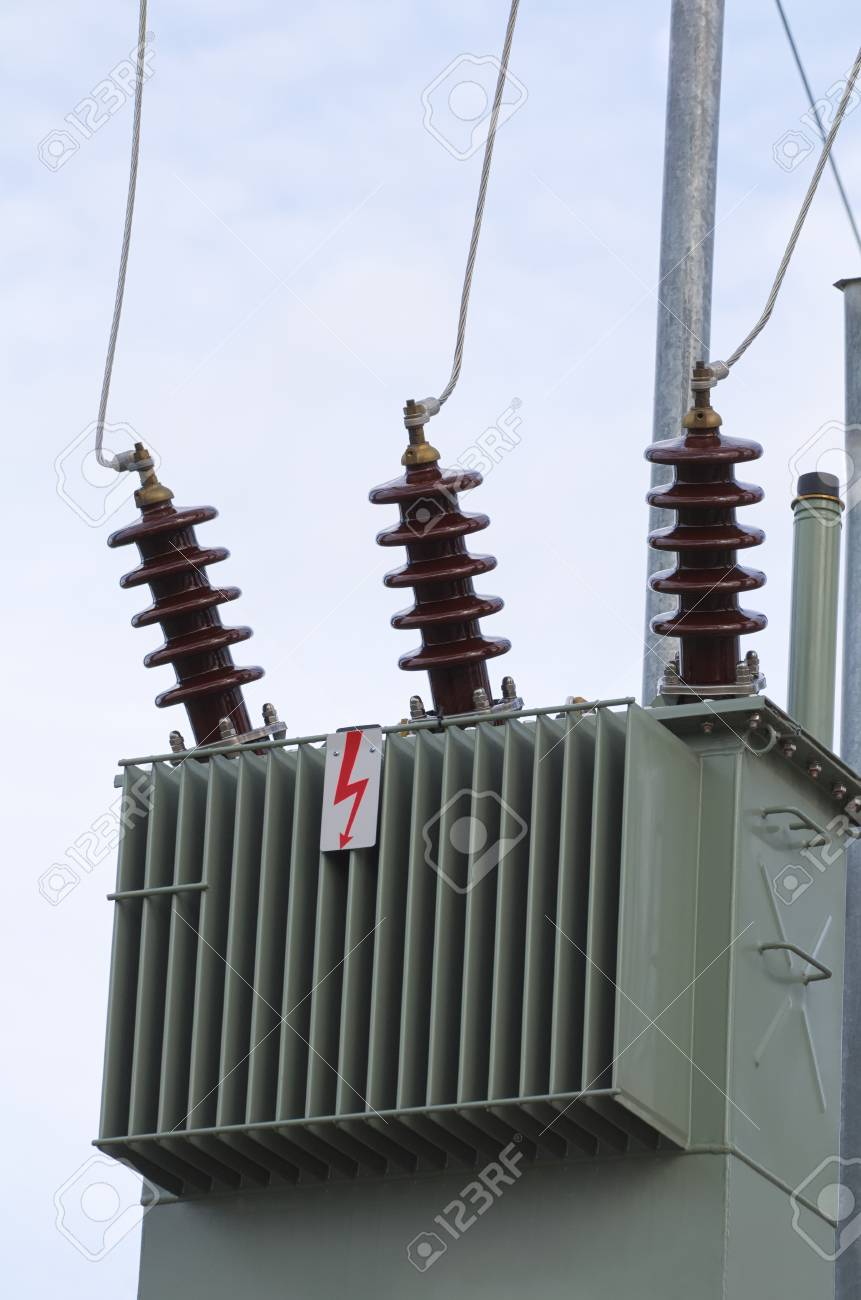 Olive Color Electric Transformer Closeup With Clear Sky Stock Photo ...