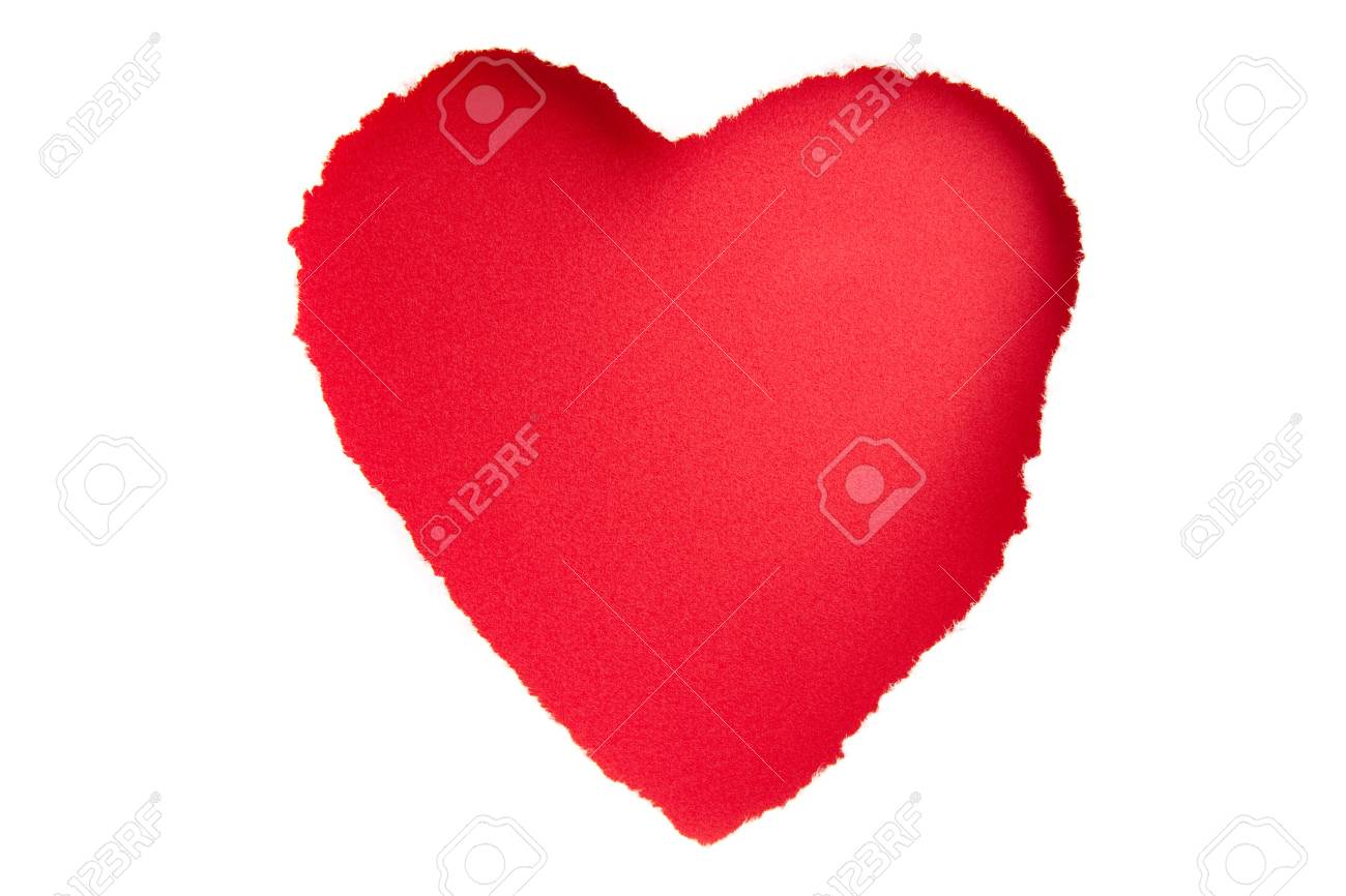 A heart shape torn out of white paper in front of some red card.  Shadow from the paper adds depth.  An unusual texture on the red card. Stock Photo - 6950184