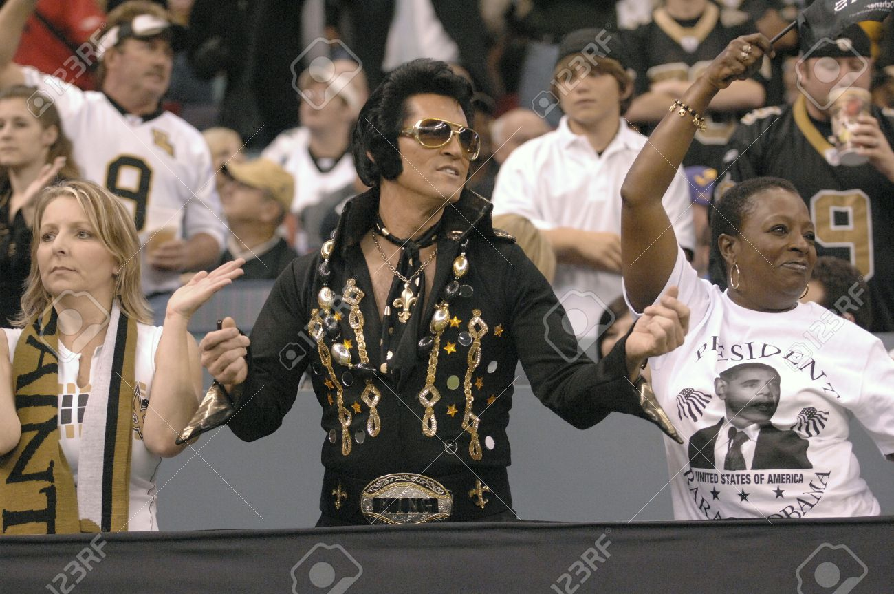 416a5ce2e New Orleans Saints fan, Saint Elvis and other fans in the stands at a New