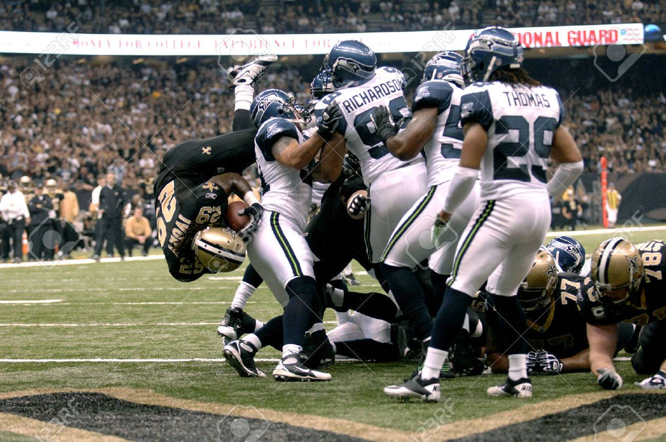 chris ivory of the new orleans saints dives over the seattle stock