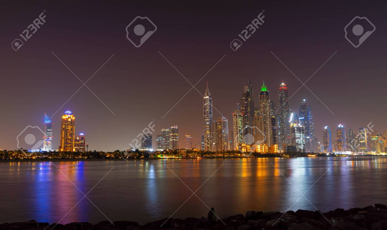 Dubai skyline at night with lights on the water and luxirious skyscrapers of UAE. Modern architecture of the future. - 138132614