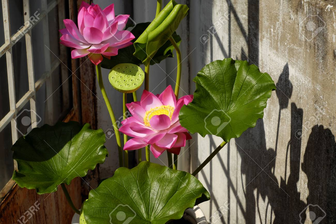 Artificial flower handmade lotus flower with green leaf and stock artificial flower handmade lotus flower with green leaf and pink petal make from clay mightylinksfo