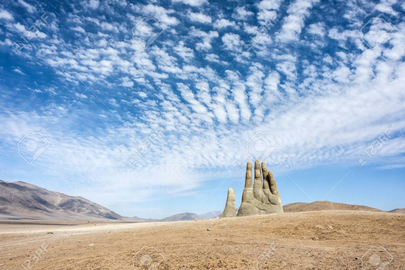 Antofagasta, April 6: Rains in the Atacama Desert washed away graffiti from the sculpture Hand of Desert (Mano de Desierto) April 6, 2014, in the Atacama Desert near Antofagasta, Chile - 81976661