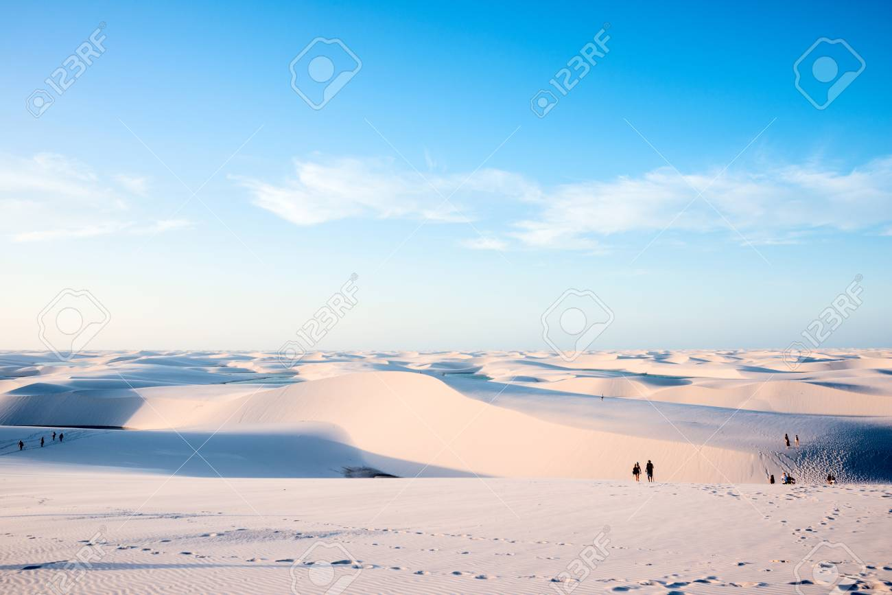 Lencois Maranhenses,Brazil, July 13, 2016 - Tourists are saying goodbye to the sun from Sand dunes with blue and green lagoons in Lencois Maranhenses National Park - 83579775