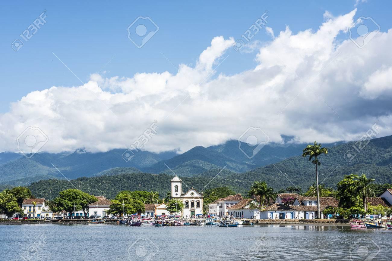 Paraty, Brazil - February 27, 2017: Tourist boats waiting for tourists near the Church Igreja de Santa Rita de Cassia in Paraty, state Rio de Janeiro, Brazil - 84693066