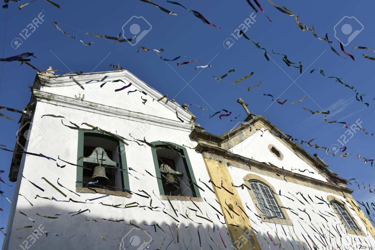 Paraty, Brazil - February 24, 2017: Typical street with colonial buildings in historic town Paraty on the time of Carnival, Brazil - 94636309