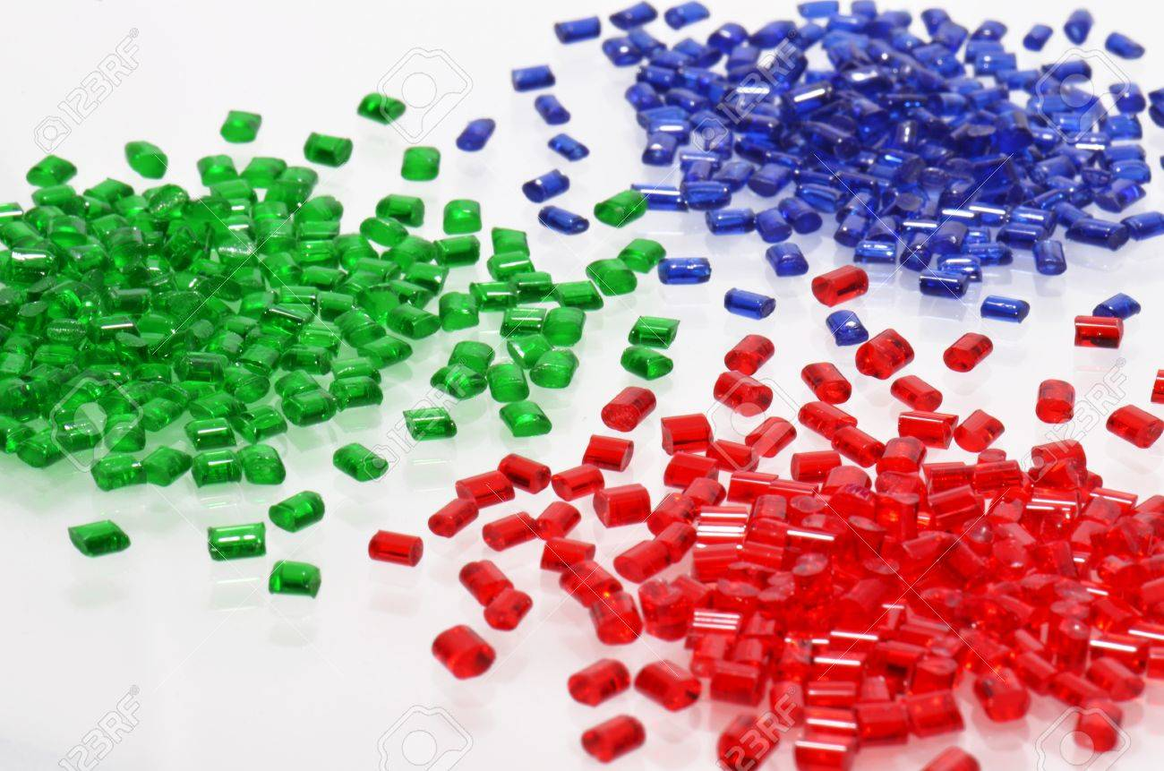 red, blue and green transparent polymer resin for injection molding on white - 12511719
