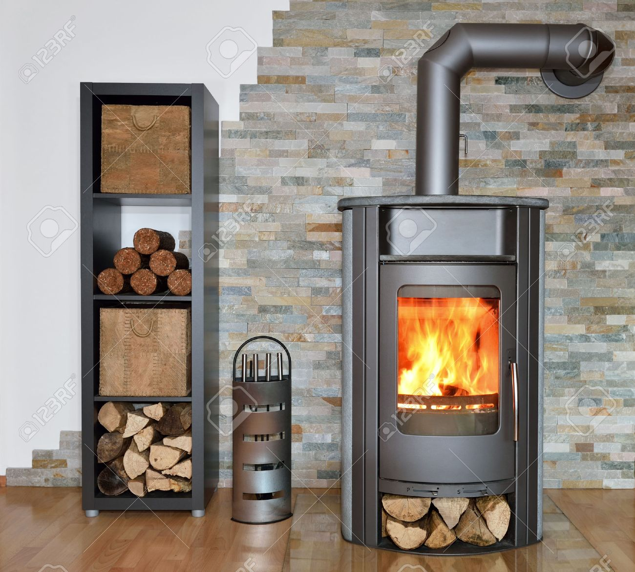 wood fired stove with fire-wood, fire-irons, and briquettes from bark Stock Photo - 24693403