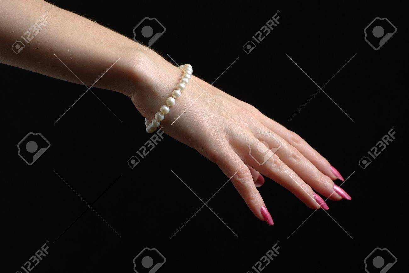 hand with a bracelet Stock Photo - 8391741