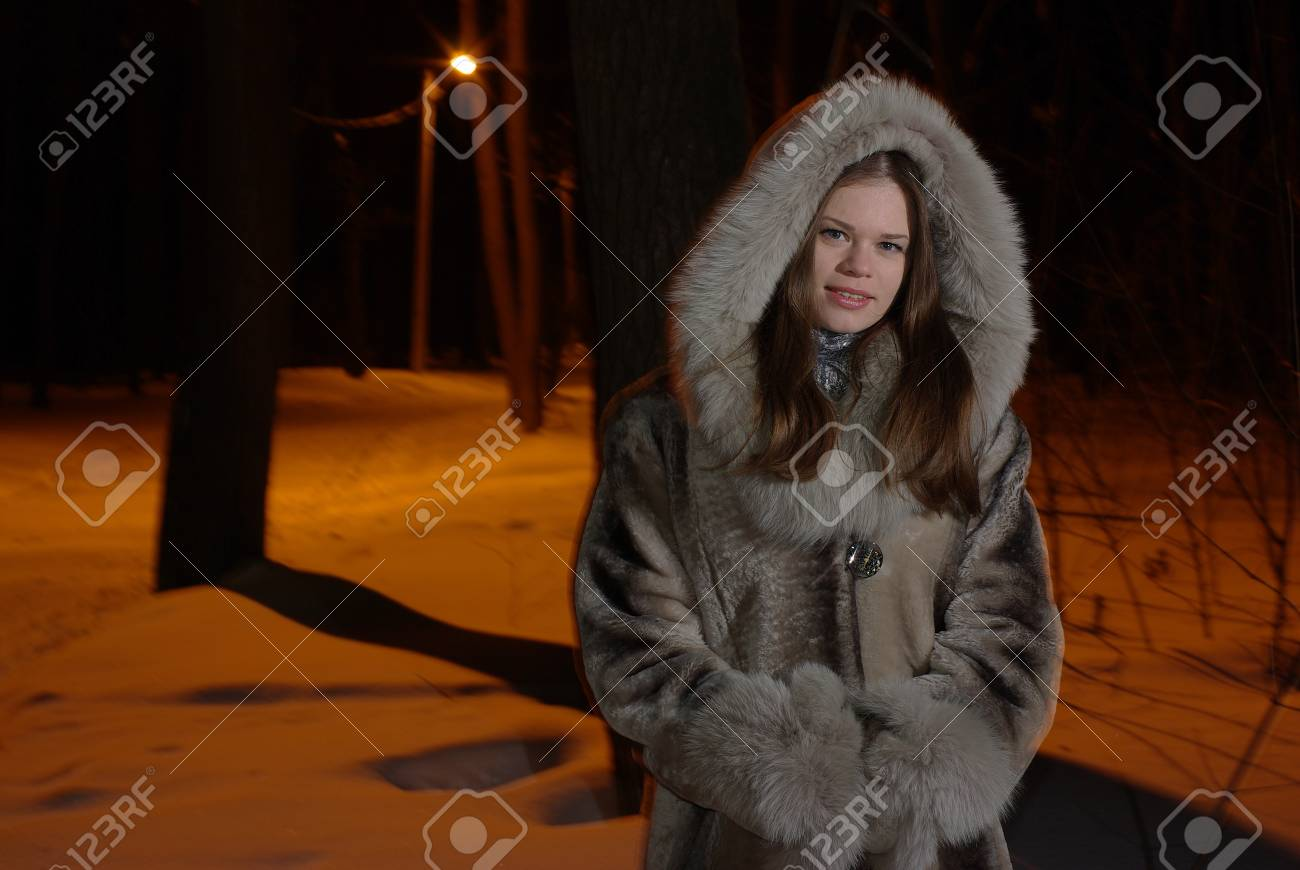 Young female walking in a winter forest Stock Photo - 9177466