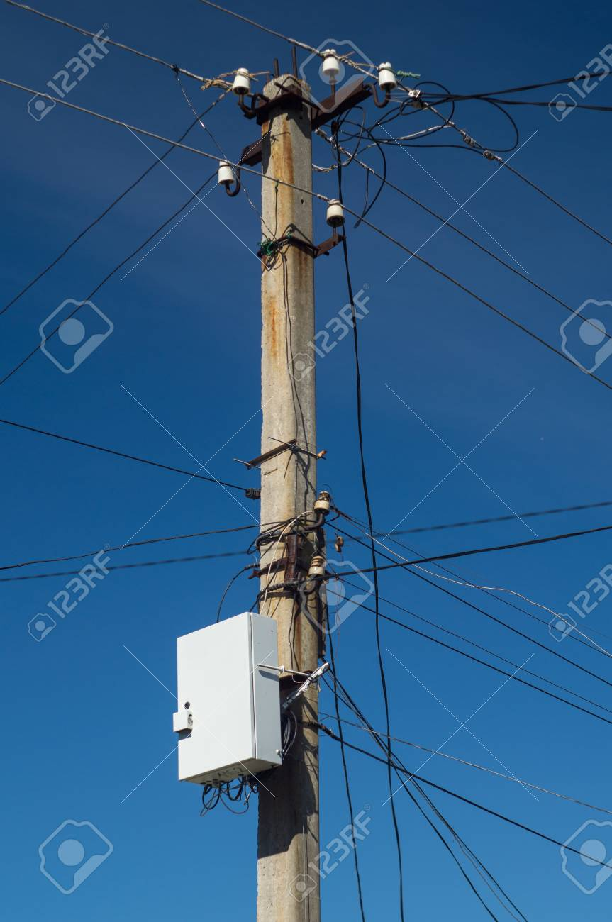 Fabulous Electric Pillar With Wires And Internet Box On Dark Blue Sky Stock Wiring Digital Resources Xeirawoestevosnl