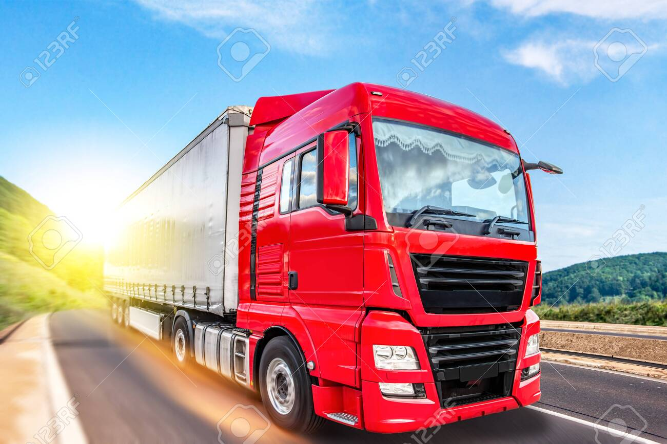Truck moves on the road at speed, delivery of goods. - 144575838