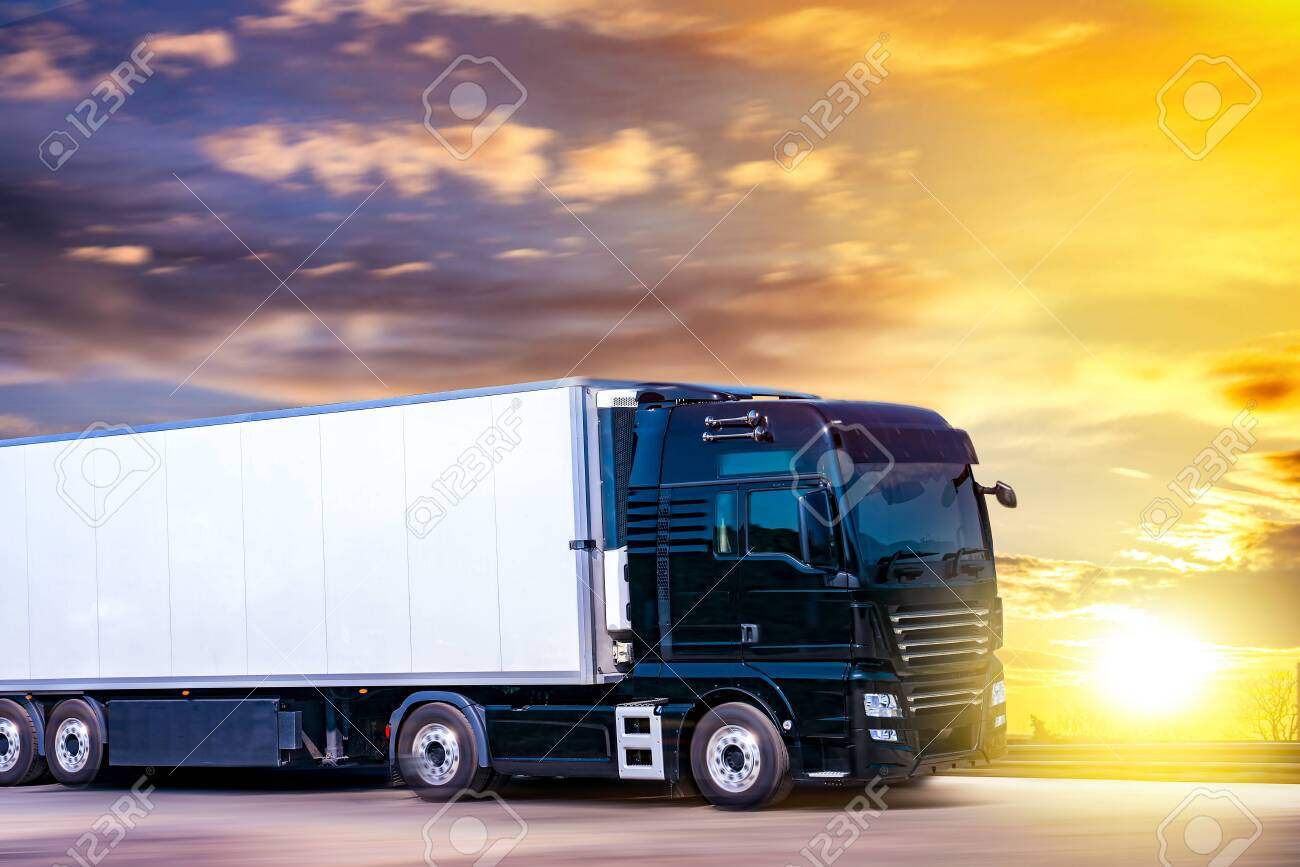 Truck moves on the road at speed, delivery of goods. Transport in Europe - 147914868