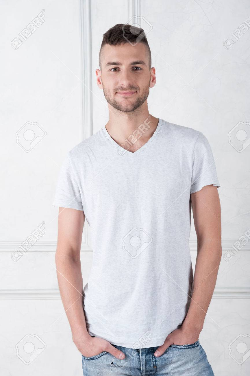 White t shirt and blue jeans -  Half Length Portrait Of Handsome Young Smiling Man Wearing White T Shirt And Suitable