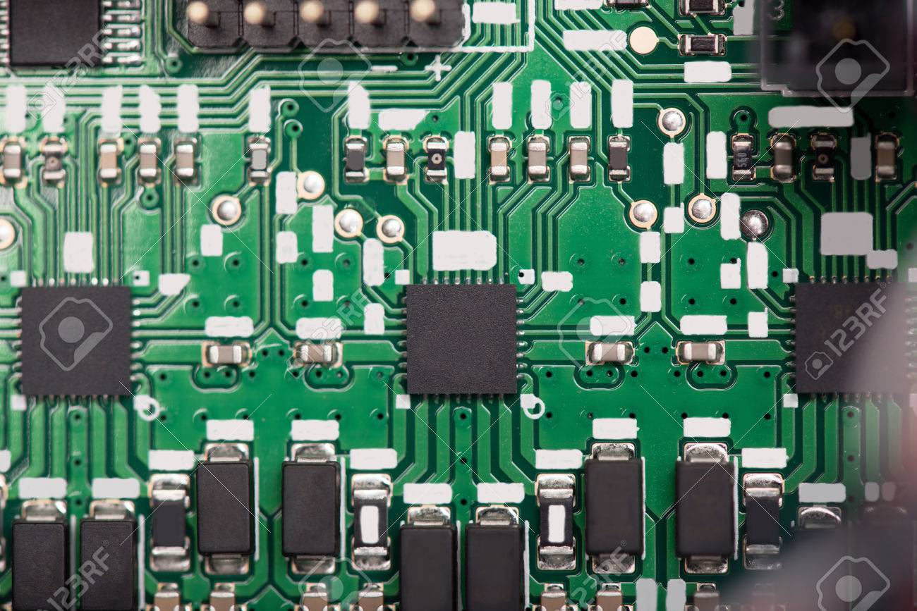 Green System Board With Microchips And Transistors Electrical Circuit Royalty Are Shown In Different Sizes Close
