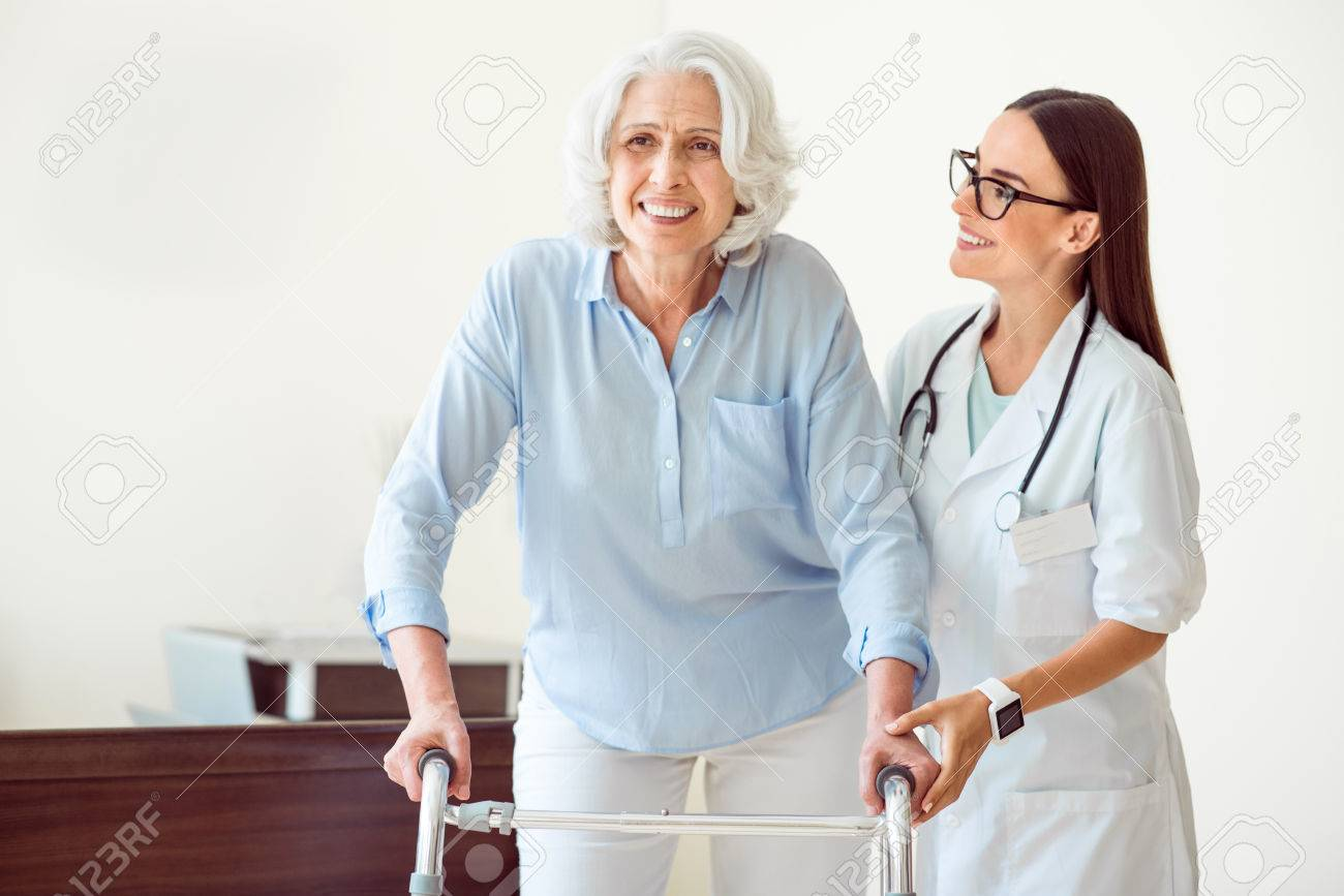 my helper cheerful and kind doctor helping smiling old woman