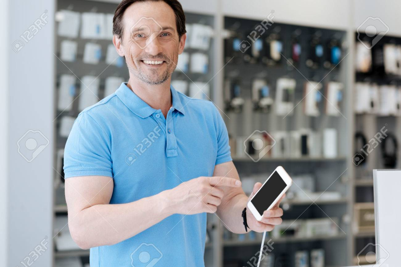 Smiling adult customer posing with phone mockup template for camera Stock  Photo - 81223047
