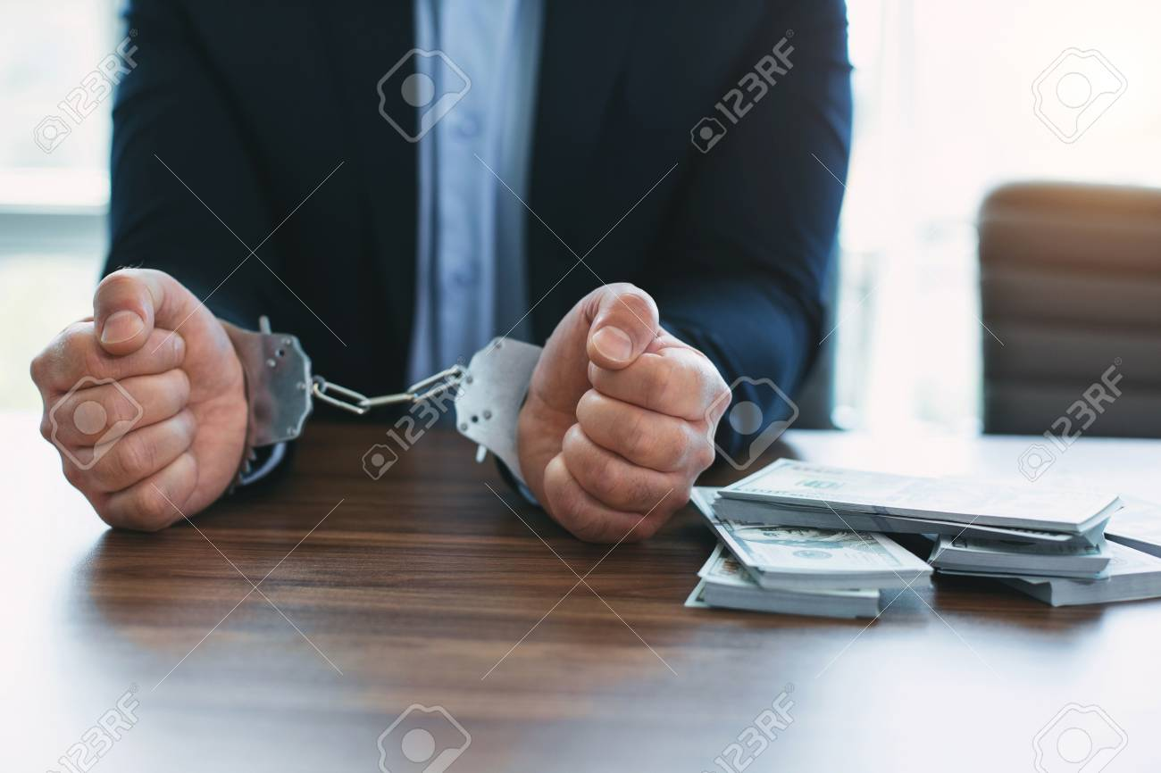 Committing a crime  Well-off high-ranking official wearing handcuffs