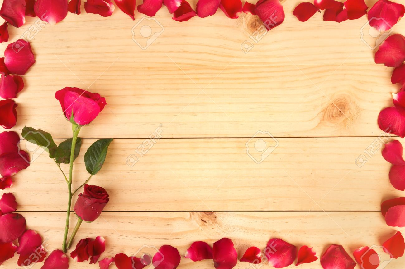 Frame Shape Made Out Of Rose Petals On Wood Background Valentines