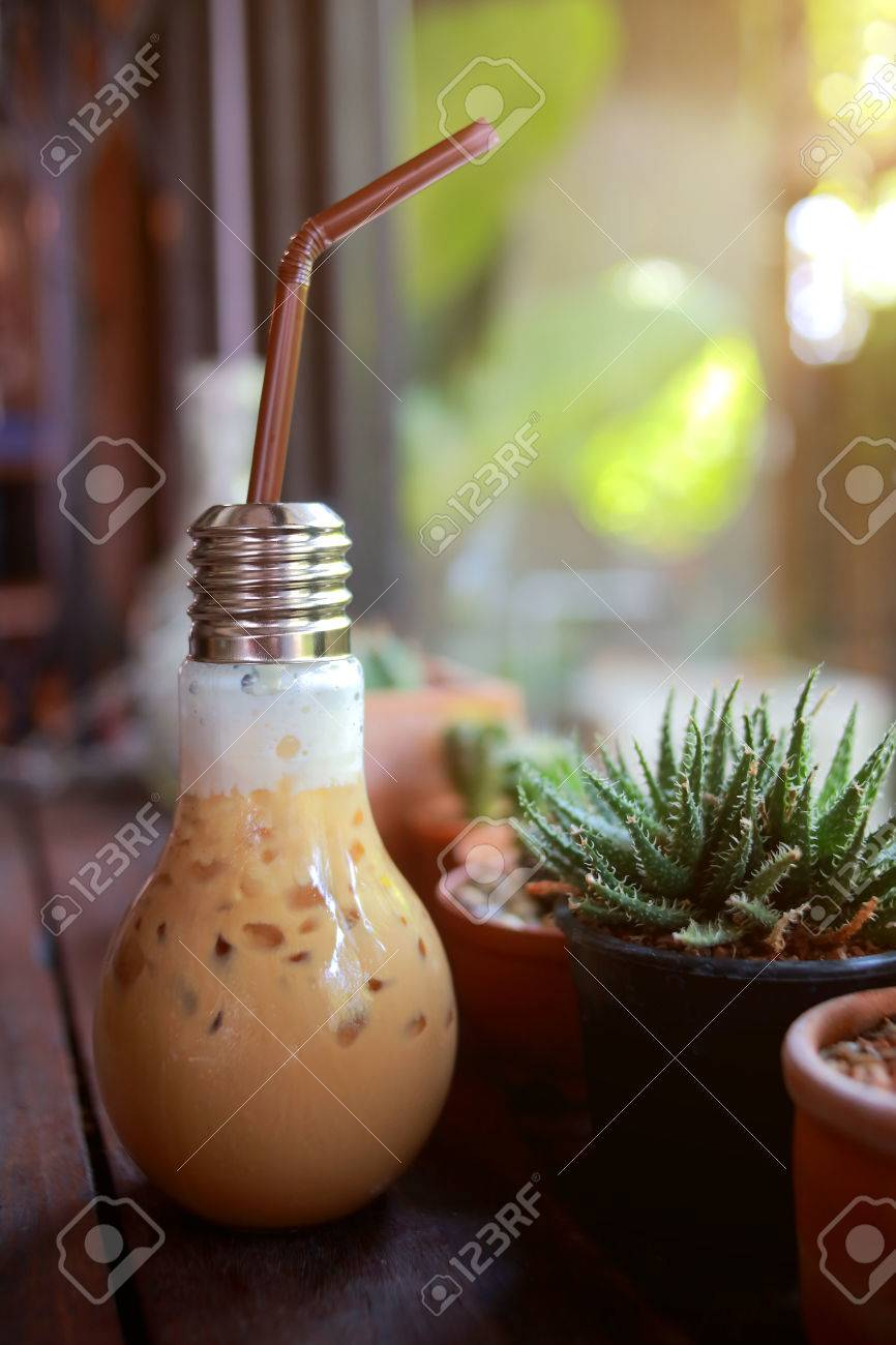 trade ideas for modern cafe coffee drinks packaged in a light bulb with a drink - Modern Cafe Ideas