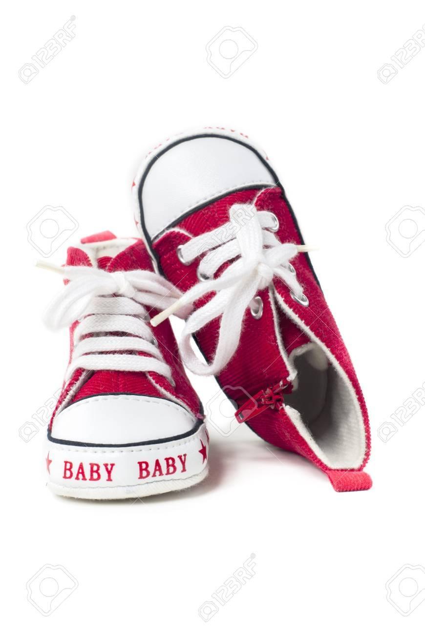 写真素材 , 白地に赤と白の赤ちゃん靴のペア