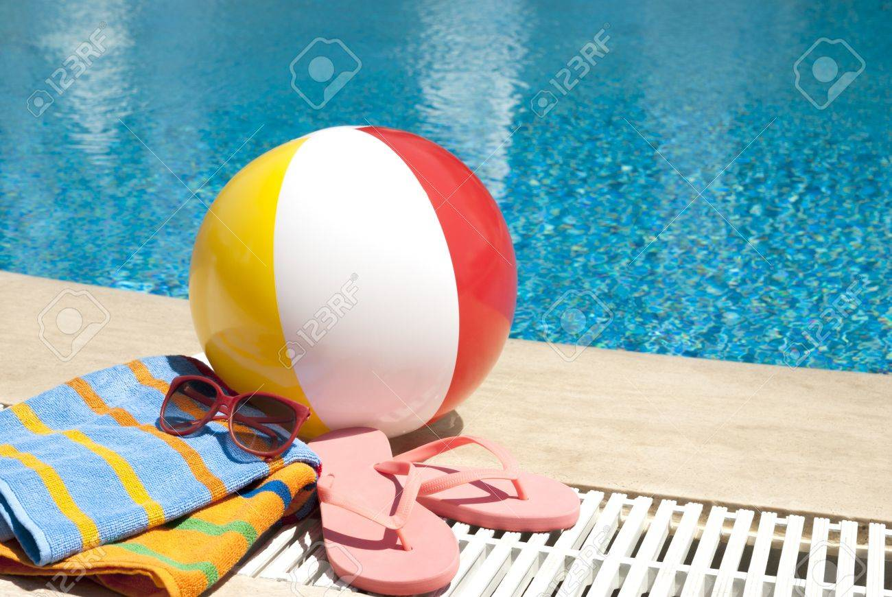 Summer vacation accessories by the swimming pool
