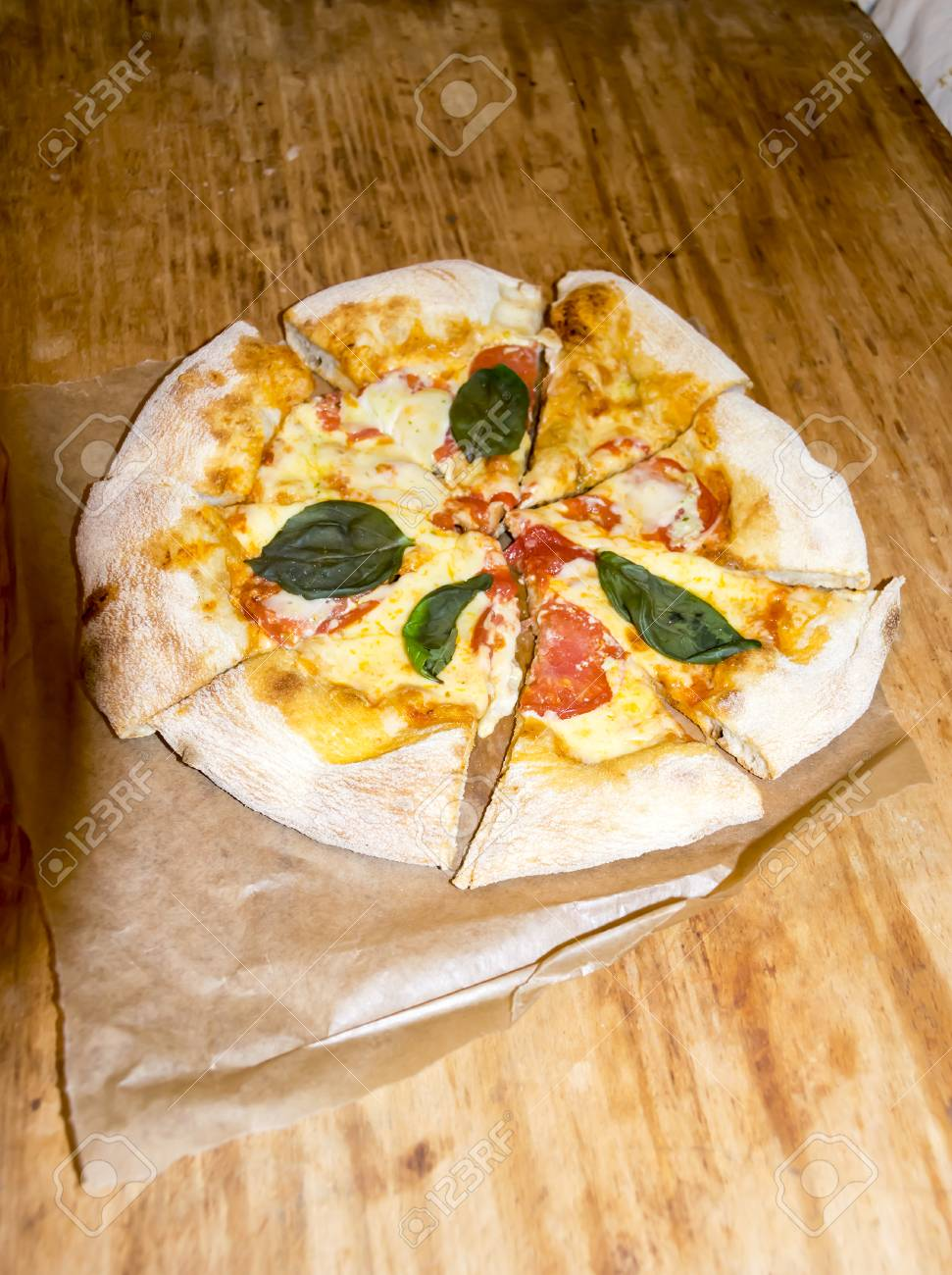 Homemade Pizza Margaritha With Mozarella And Basil Stock Photo
