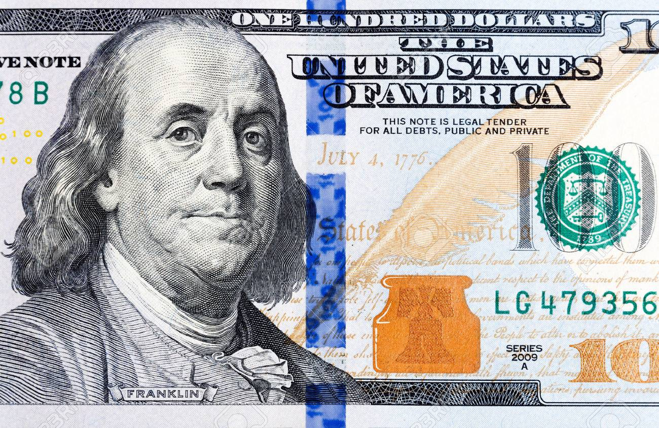 Macro Sof And New One Hundred Dollar Bill Showing The Face Of Benjamin Franklin