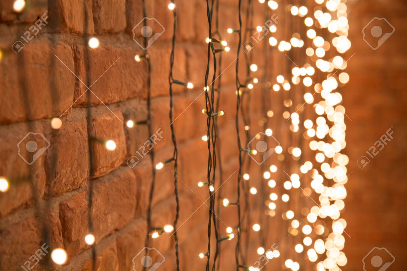 What Can I Use To Attach Christmas Lights To Brick decorative christmas garland with lanterns hanging on the brick
