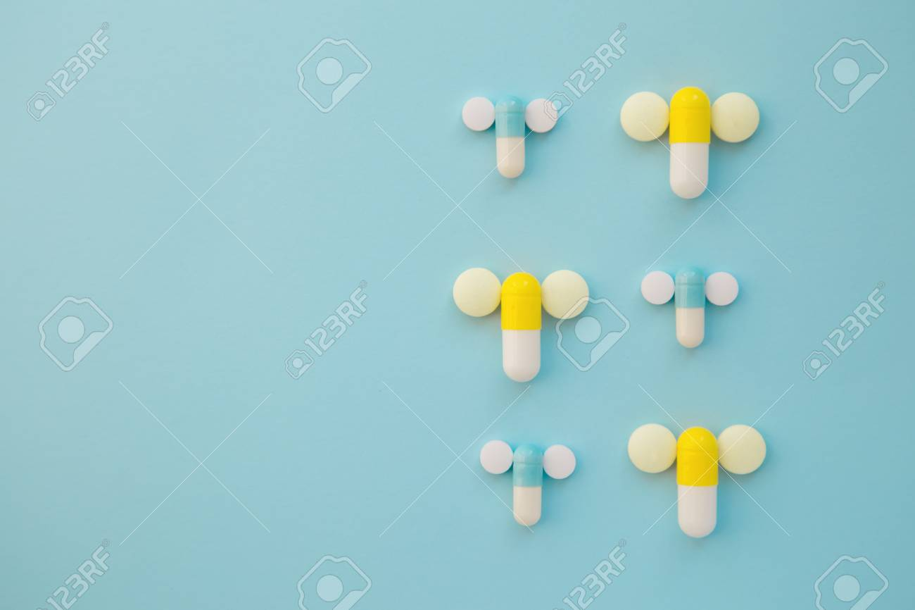 Penis Symbol Made Out Of Medical Yellow And Blue Capsules And